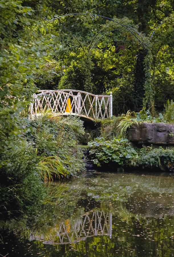 Swiss Garden in Biggleswade. Bridge in Swiss Garden in Old Warden Park located in Biggleswade on the River Ivel in Bedfordshire, England stock image