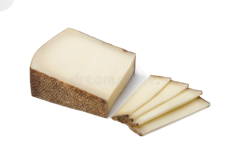 Swiss Gruyere cheese ans slices. Piece of Swiss Gruyere cheese ans slices on white background royalty free stock photography