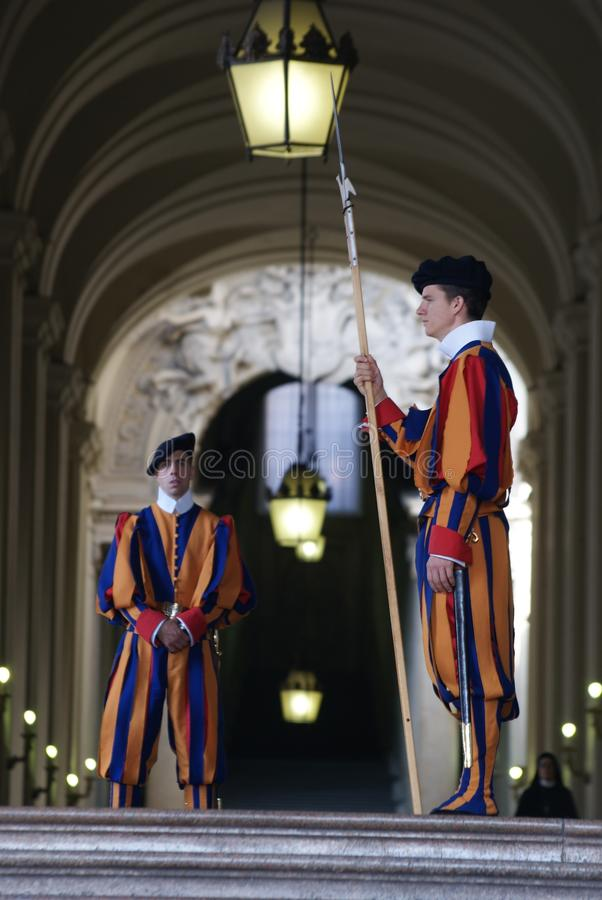 Swiss guard in Vatican city. VATICAN CITY, VATICAN - OCTOBER 4: Members of the Pontifical Swiss Guard stand guard in Saint Peters Basilica on October 4, 2010 stock image