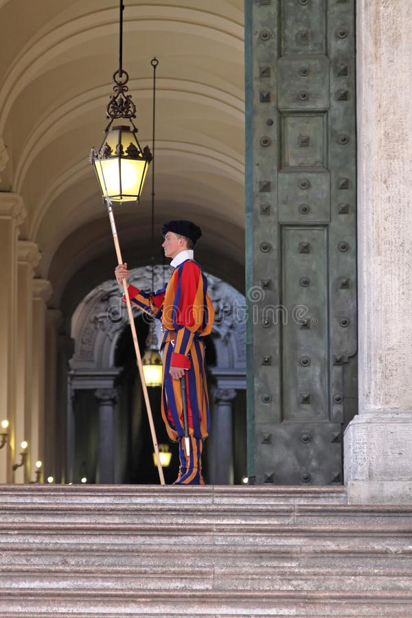 Swiss Guard Vatican. Vatican - October 26, 2009: Member of the Pontifical Swiss Guard at Entrance in Vatican City stock photography