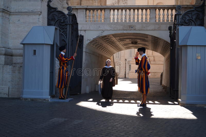 Swiss guards greeting nun royalty free stock photography