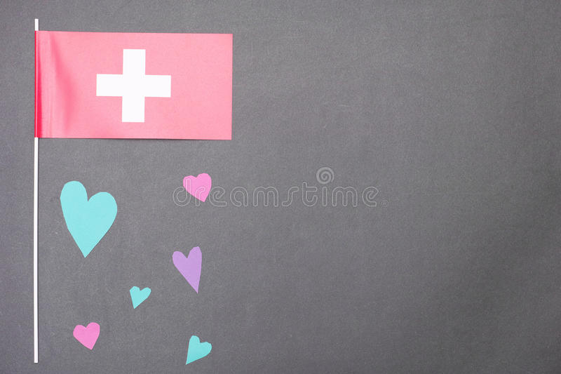Swiss love. Colorful real cut out of paper hearts for your romantic or healthcare copy about Swiss - copy space to the right royalty free stock photos
