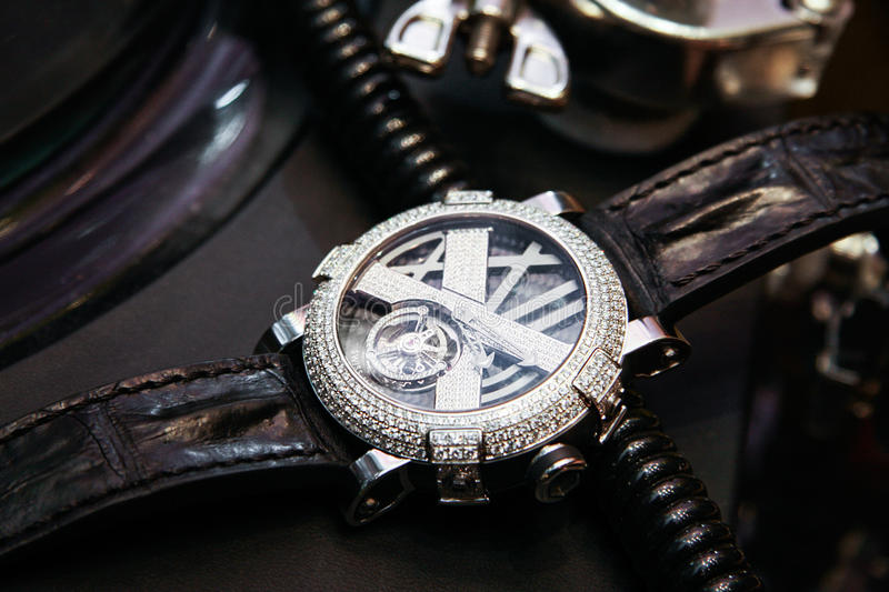 Swiss luxury watch with diamonds on the table. Men fashion. Men or women accessories royalty free stock images