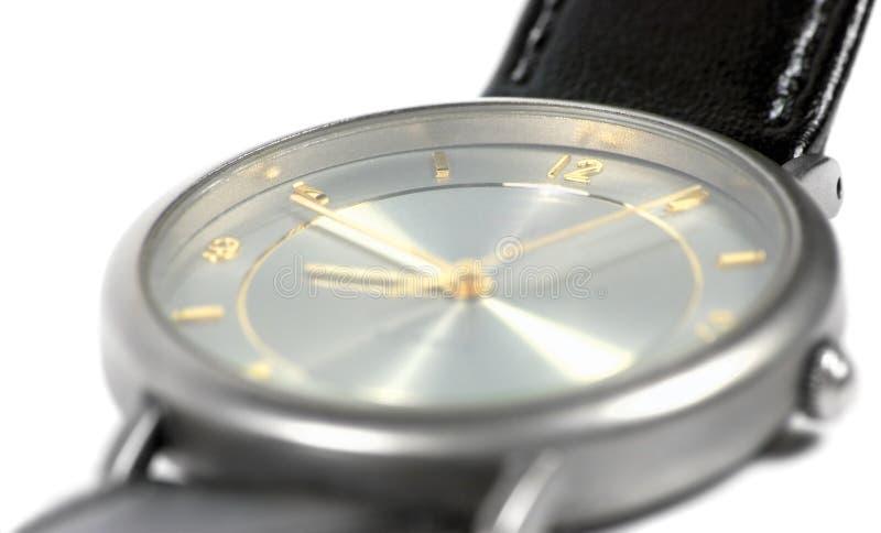 Swiss made watch face titanium case flat sapphire glass gold grey classic style luxury men's wristwatch detailed macro closeu royalty free stock photography