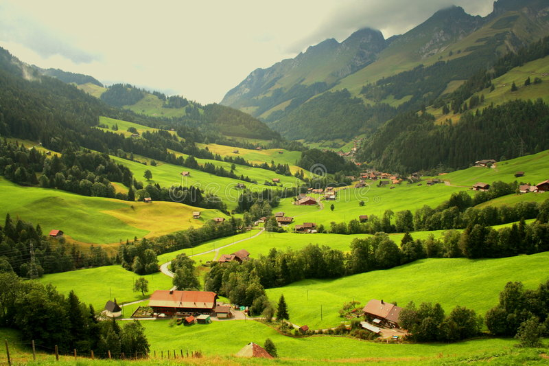 Swiss mountain chalets. The image of the Swiss valley was taken in August 2005. Near to the village of Gruyere stock photos
