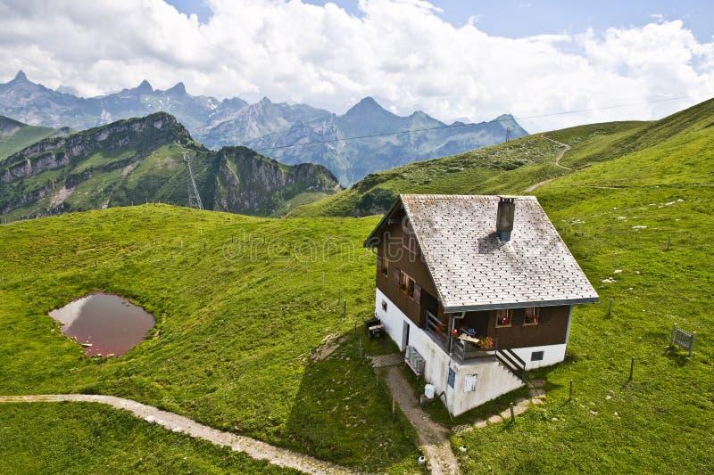 Swiss mountain house stock photo