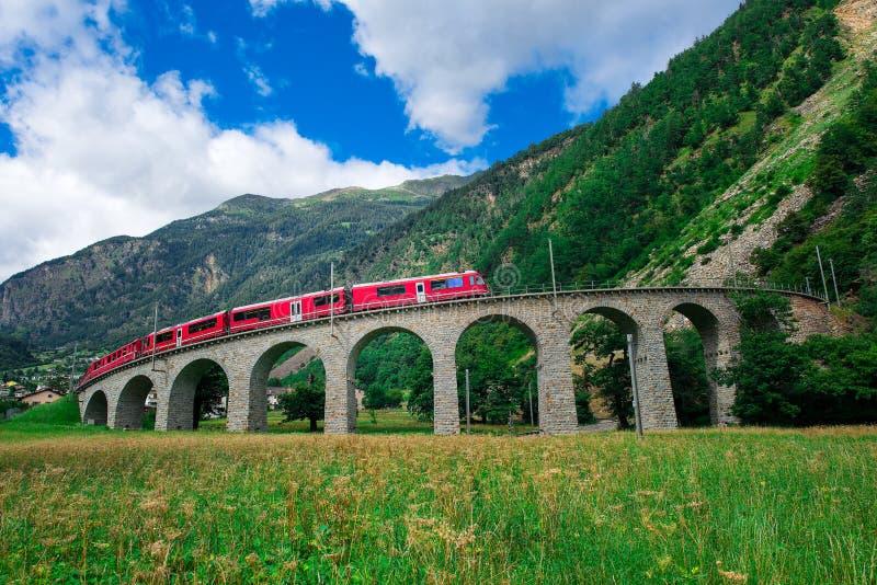 Swiss mountain train Bernina Express Cross the bridge in the cir stock photography
