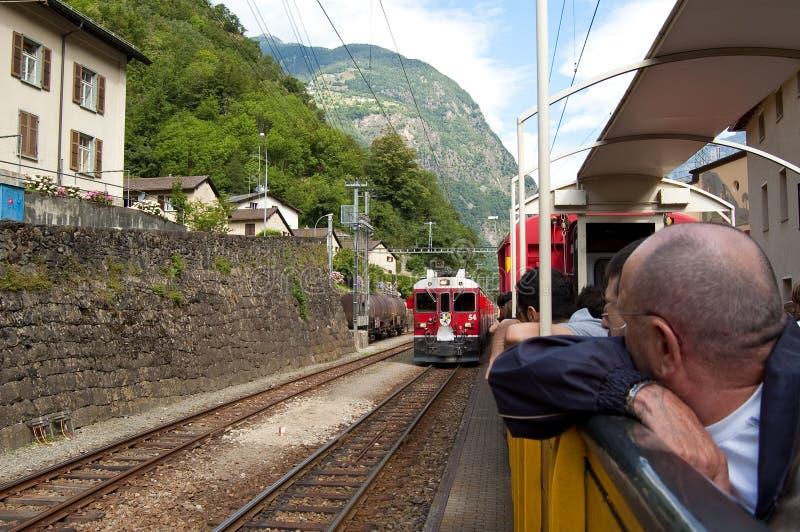 Swiss mountain train Bernina Express crossed through the high mo royalty free stock photo