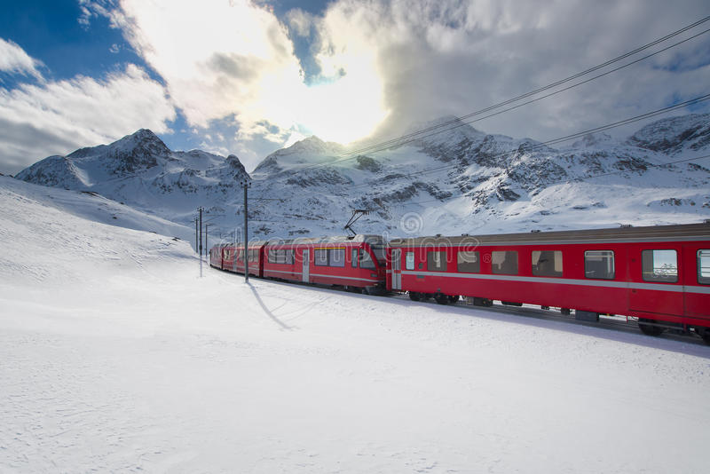Swiss mountain train Bernina Express crossed through the high mo stock images