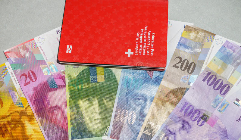 Swiss passport and money royalty free stock image