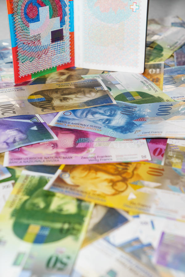 Swiss passport and money. Currencies royalty free stock photo