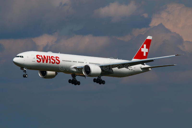 Swiss. PRAGUE, CZECH REPUBLIC - APRIL 6: Brand new Swiss Boeing B777-300 arrival to PRG Airport on April 6, 2016. Swiss International Air Lines is the flag stock photo