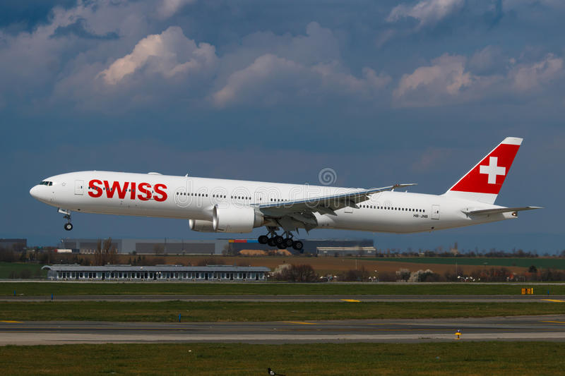 Swiss. PRAGUE, CZECH REPUBLIC - APRIL 6: Brand new Swiss Boeing B777-300 arrival to PRG Airport on April 6, 2016. Swiss International Air Lines is the flag royalty free stock image