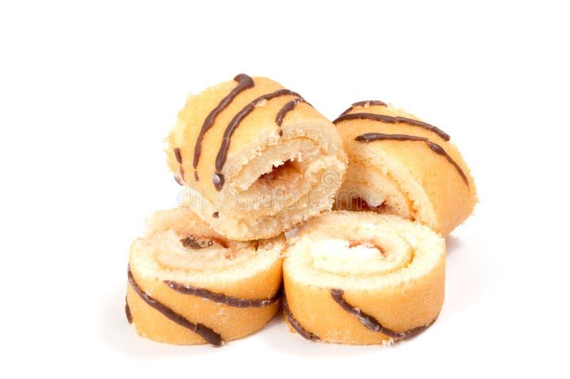 Swiss roll del biscotto su bianco fotografia stock libera da diritti