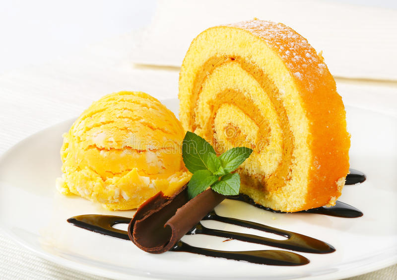 Swiss Roll with yellow sherbet royalty free stock images