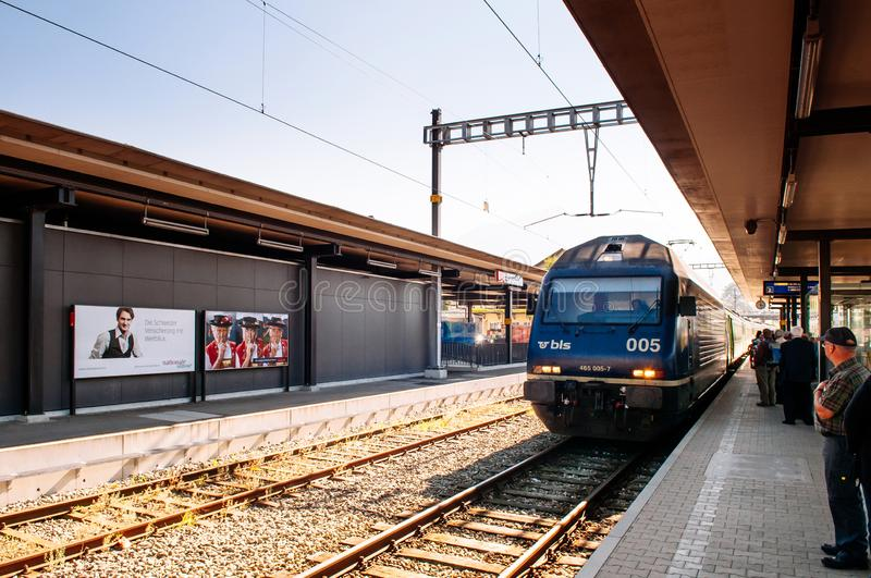 Swiss Bahn train approaching station platform with passengers stock images