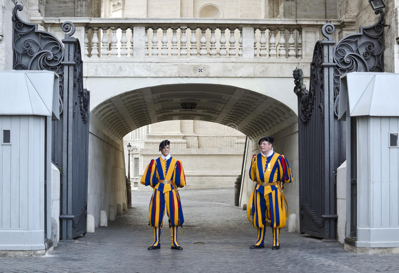 Swiss soldiers guarding Vatican entrance. The Pontifical Swiss Guard of Vatican is responsible for the security and safety of the Pope as well as the Papal stock photography