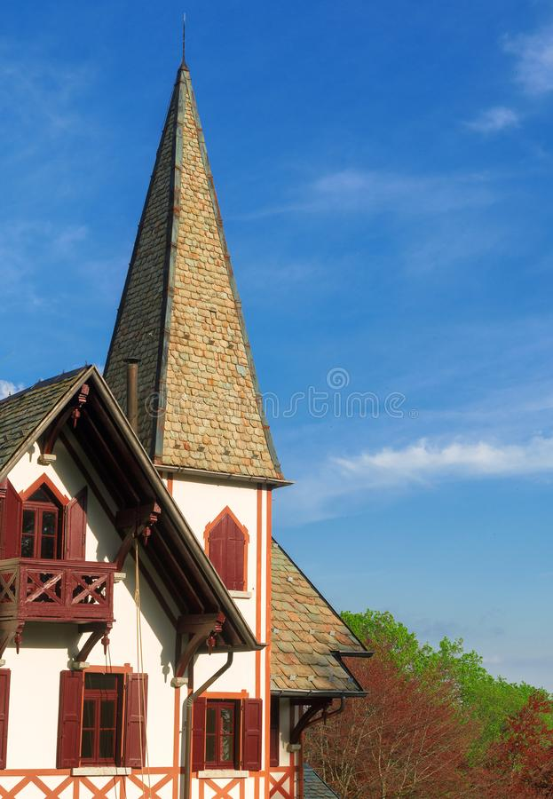 Swiss-style house in the Alpine mountains. stock photography
