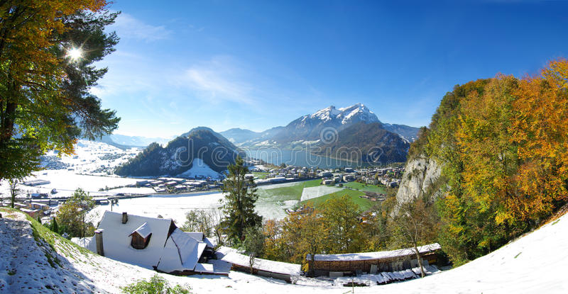 Swiss town and mountains in winter royalty free stock image