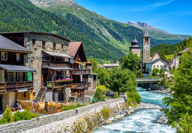 Swiss village in Alps mountains, Grisons, Switzerland royalty free stock photo
