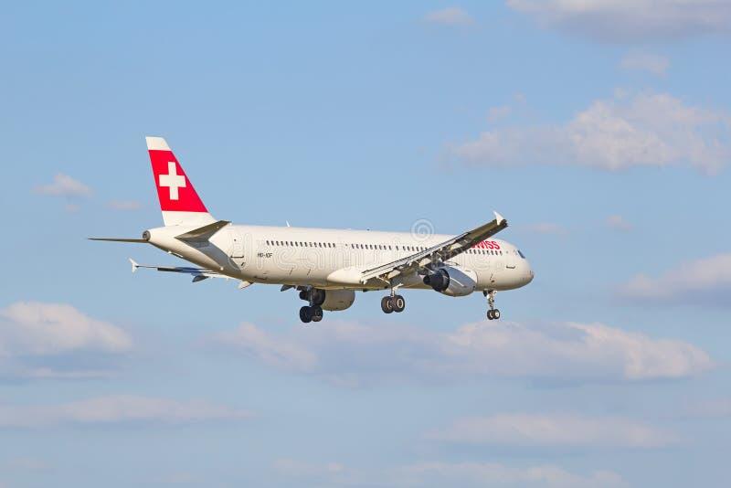 Swiss A-320. ZURICH - JULY 18: Swiss A-320 landing in Zurich airport after short haul flight on July 18, 2015 in Zurich, Switzerland. Zurich airport is home port stock image