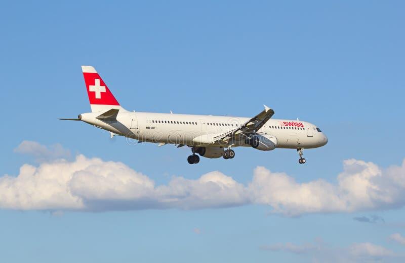Swiss A-320. ZURICH - JULY 18: Swiss A-320 landing in Zurich airport after short haul flight on July 18, 2015 in Zurich, Switzerland. Zurich airport is home port stock photos