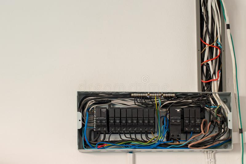 Switch electrical safety circuit breaker box. The circuit old breakers in Control box. The circuit breaker board main switch. A finger is about to switch off a stock images