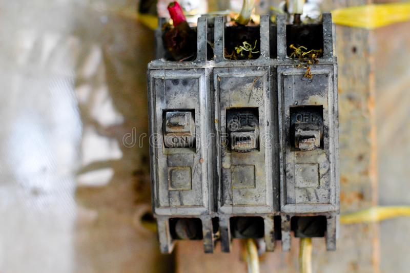 Switch electrical safety circuit breaker box, damaged by the sun,. In poor conditions to function royalty free stock photo