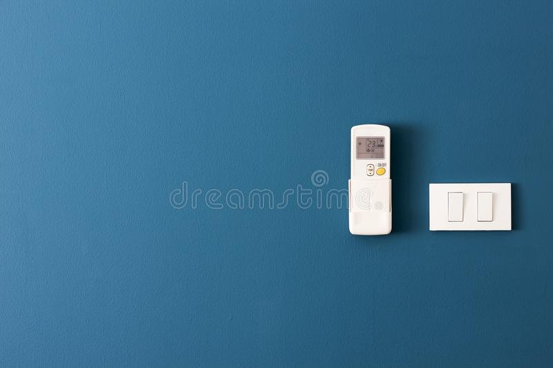 Switch off - turn and air remote control on the blue wall royalty free stock images
