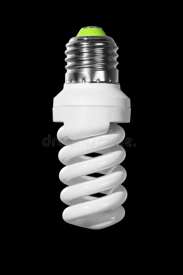 Switched off compact fluorescent Lamp with spiral tube isolated on a black. Background royalty free stock image