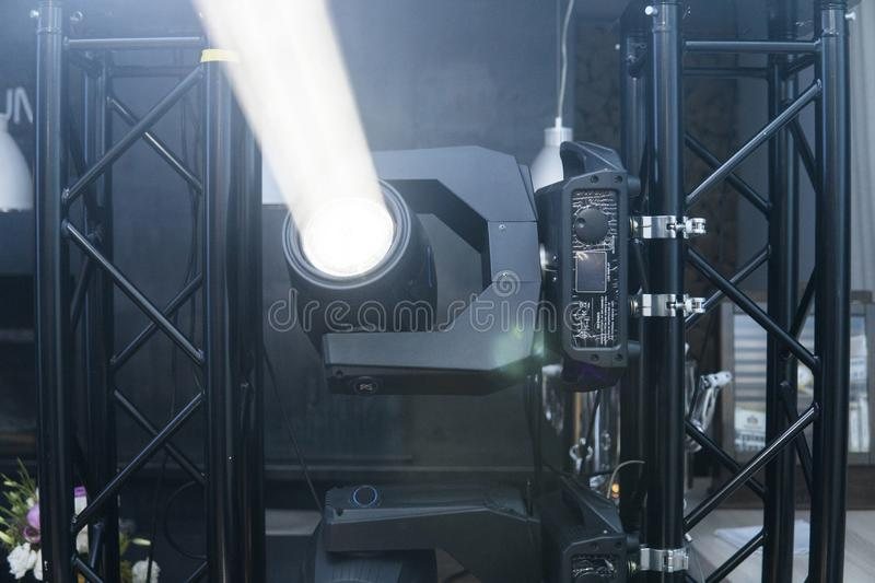 Switched on stage lights under the white light. Light moving head for event and concert stage. stock photography
