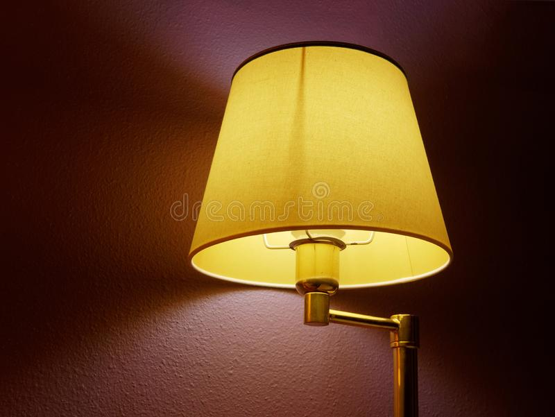Switched on tablet lamp. Switched on table lampada indoor royalty free stock image