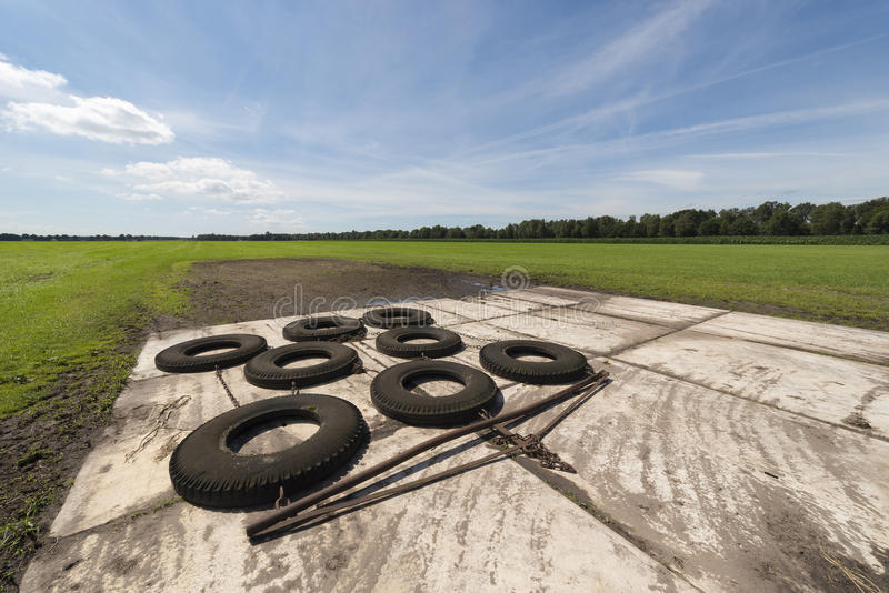 Switched tires to level out bumpy agricultural field stock image