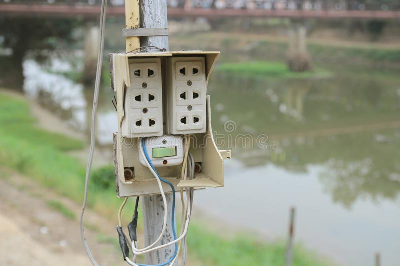 Switches, old and dirty plugs. Risk of danger. on the pole outside stock photography