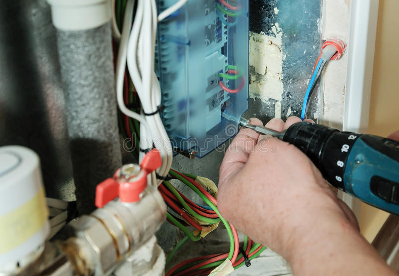 Switching signal wires in the home`s heating system control. royalty free stock photography