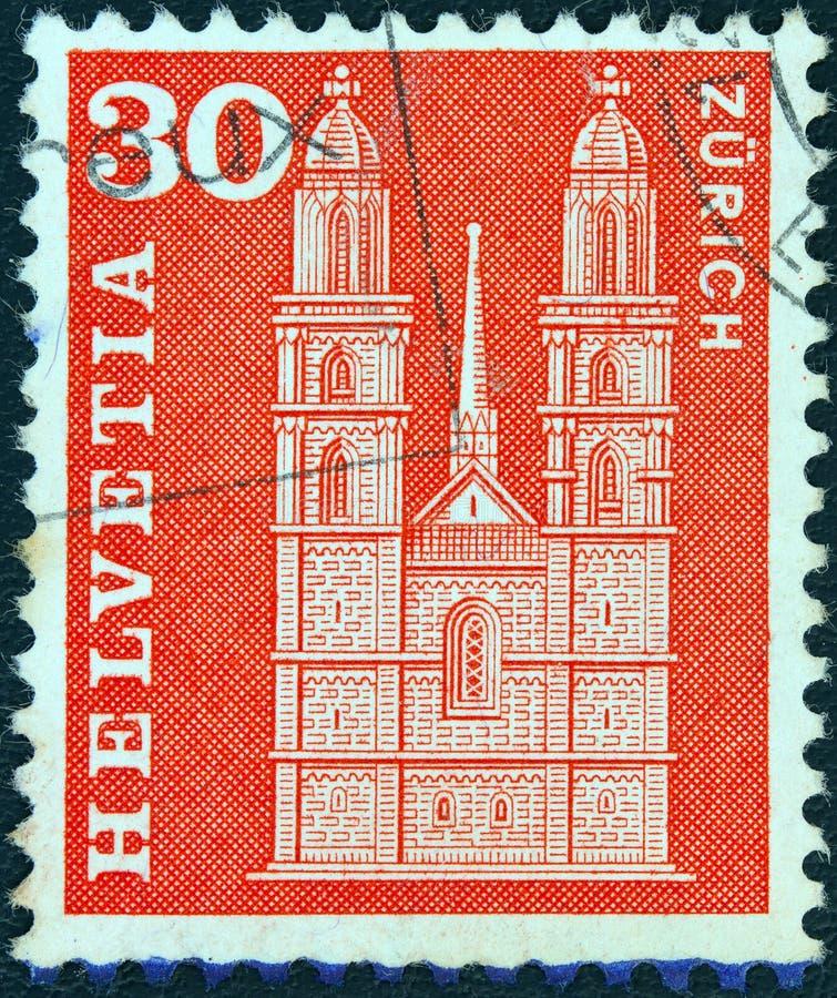 SWITZERLAND - CIRCA 1960: A stamp printed in Switzerland shows Grossmunster church, Zurich, circa 1960. stock photography
