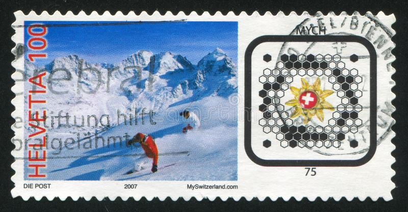Skiers and Swiss Post BeeTagg royalty free stock photos