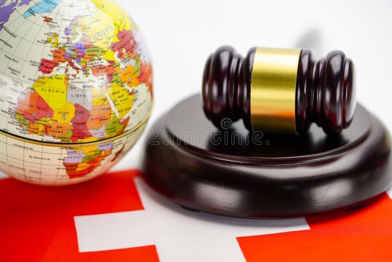 Switzerland flag and Judge hammer with globe world map. Law and justice court. Switzerland flag and Judge hammer with globe world map. Law and justice court stock photo