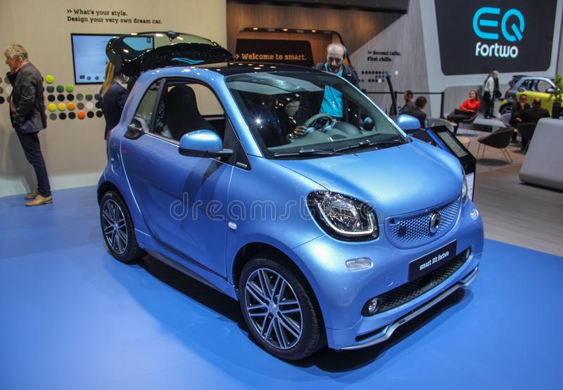 Switzerland; Geneva; March 8, 2018; The blue Smart EQ fortwo, front side from right; the 88th International Motor Show in Geneva. From 8th to 18th of March royalty free stock image