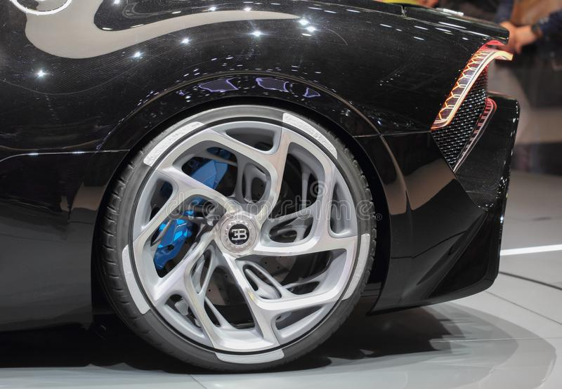 Switzerland; Geneva; March 10, 2019; A close up of Bugatti - La Voiture Noire left rear wheel; The 89th International Motor Show. In Geneva from 7th to 17th of stock images