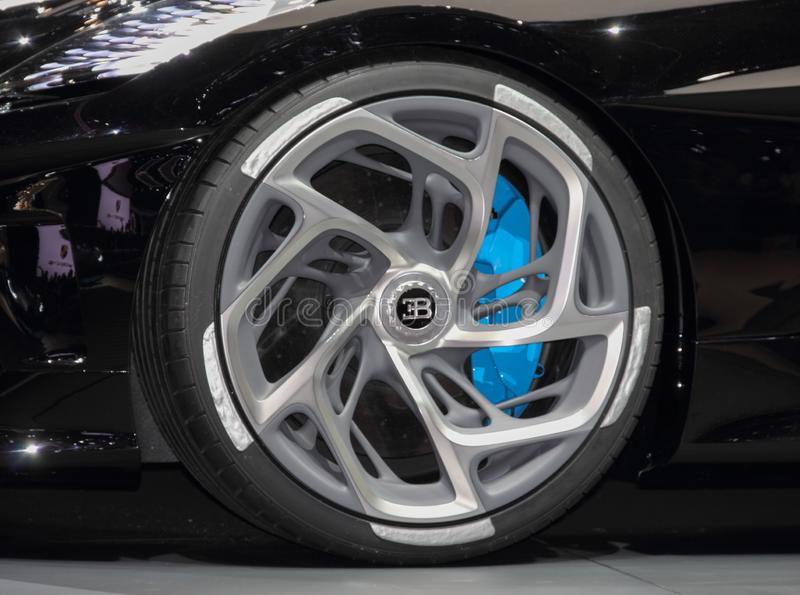 Switzerland; Geneva; March 10, 2019; A close up of Bugatti - La Voiture Noire wheel; The 89th International Motor Show in Geneva. From 7th to 17th of March royalty free stock image