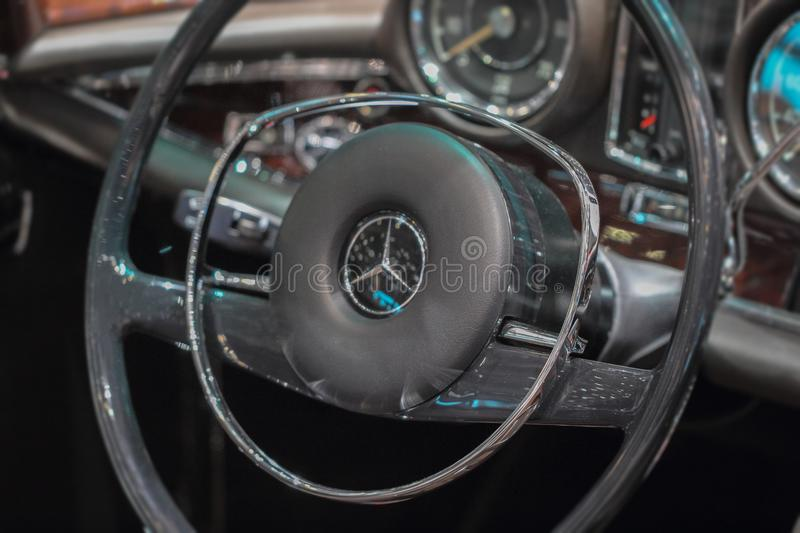 Switzerland; Geneva; March 8, 2018; The close up of Merc. Edes-Benz 280 SL Pagoda steering wheel; the 88th International Motor Show in Geneva from 8th to 18th of stock photo