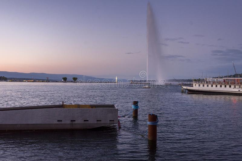 Switzerland Geneva Sunrset on the lake Leman in the summer time. Sunset on Lake Leman and the famous water jet of Geneva stock photo