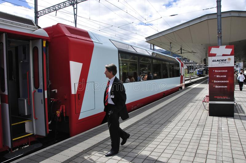 Switzerland: The Glacier Express train is connecting the three t royalty free stock photo