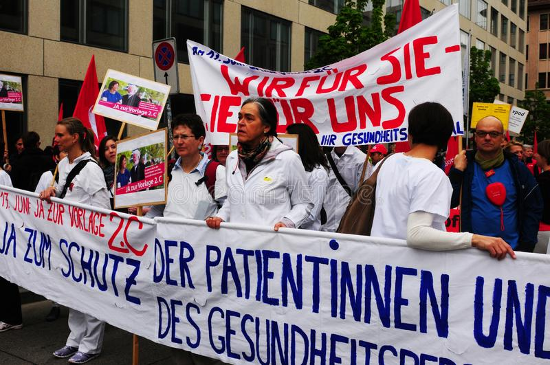 Switzerland: health labour protestors parade in Zürich city stock photos