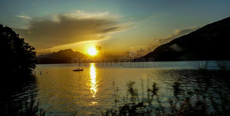 Switzerland, Lauterbrunnen, SCENIC VIEW OF LAKE AGAINST SKY DURING SUNSET. Switzerland, Lauterbrunnen, Europe, SCENIC VIEW OF LAKE AGAINST SKY DURING SUNSET stock image