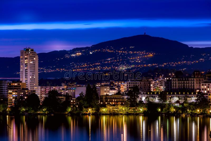 Switzerland, Montreux, night view with lake. Switzerland, Montreux, cityscape dusk night view with Lake Geneva and Alps stock images