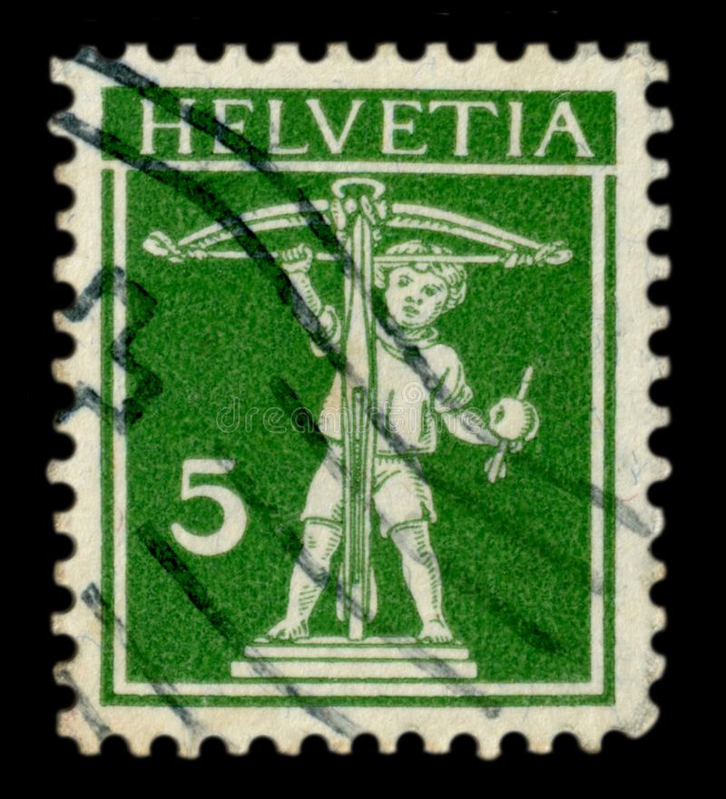 Switzerland - 13 Nov 1914: Swiss historical stamp: Son of William tell with a crossbow, an Apple with an arrow, Helvetia postmark. Cancellation,  world war one royalty free stock images
