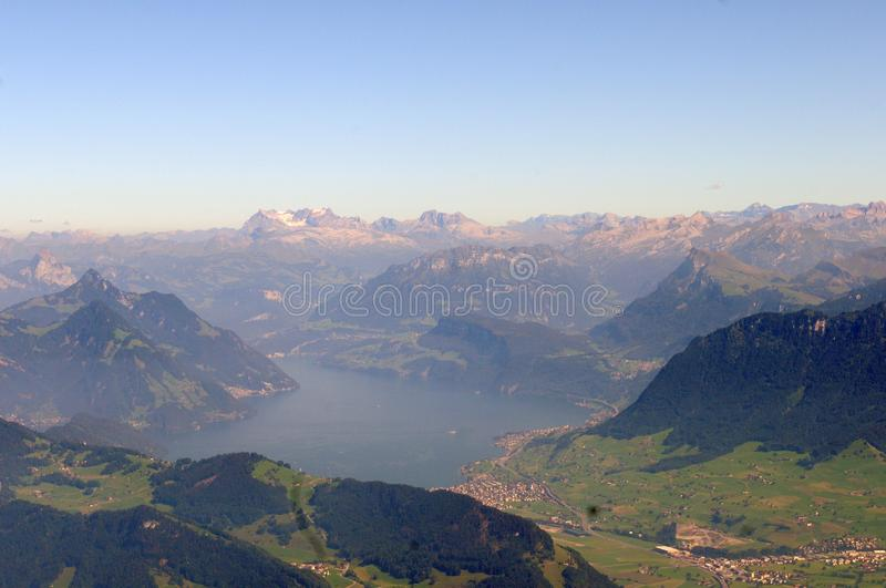 Switzerland: Panoramic view from Pilatus Peak over the swiss alps. To the Finsterahorn and glaciers royalty free stock image