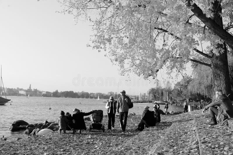 Switzerland: people enjoying autumn colors at Lake Zürich stock photo